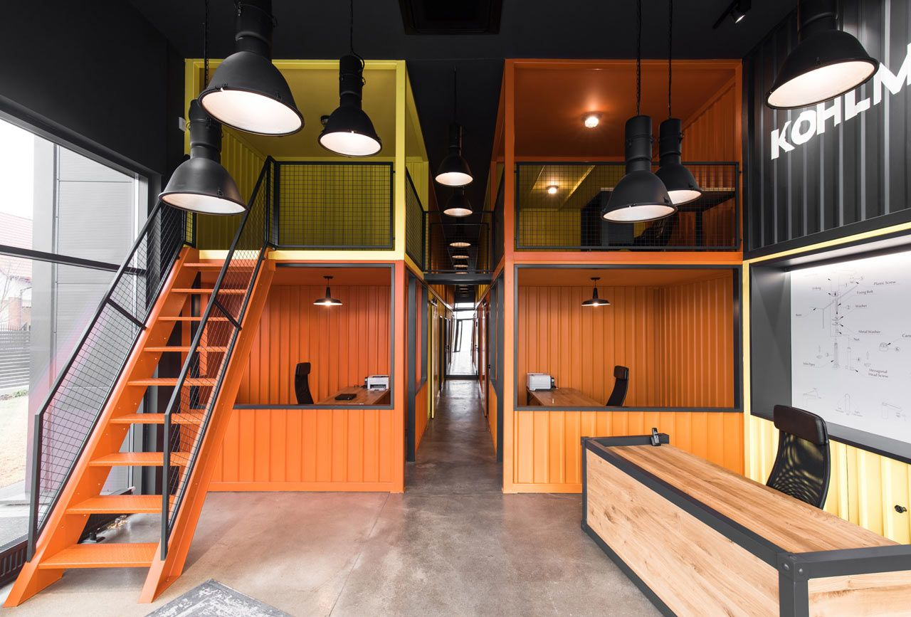 Shipping containers were the inspiration behind mode:lina's new offices for bathroom fixtures brand, KOHLMAN, in the town of Cieplewo, Poland.