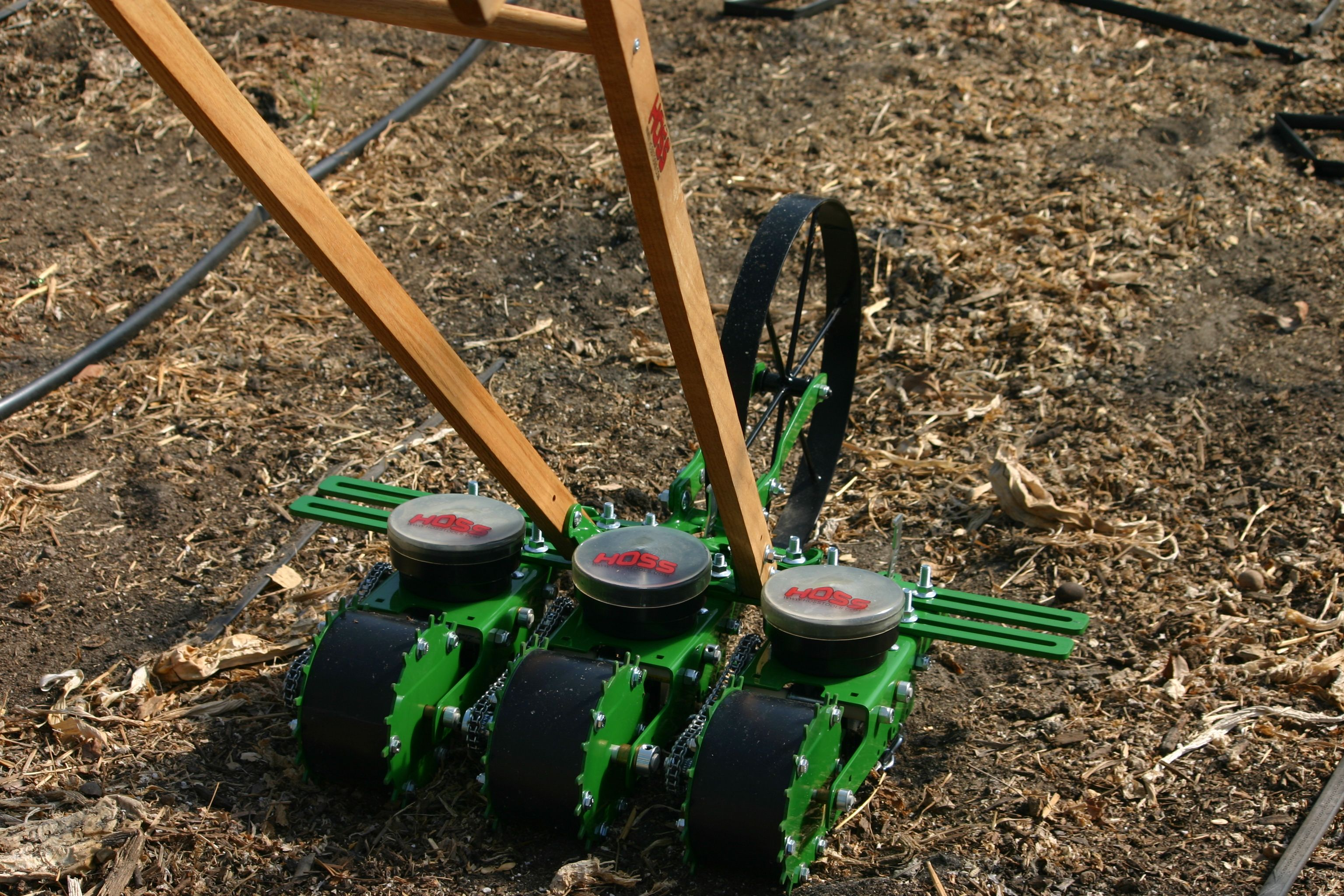 This Incredible Wheel Hoe And Seeder Setup Allows You To Plant Multiple Rows At A Time Using Four Spreader Bar Extens Home Vegetable Garden Garden Tools Garden