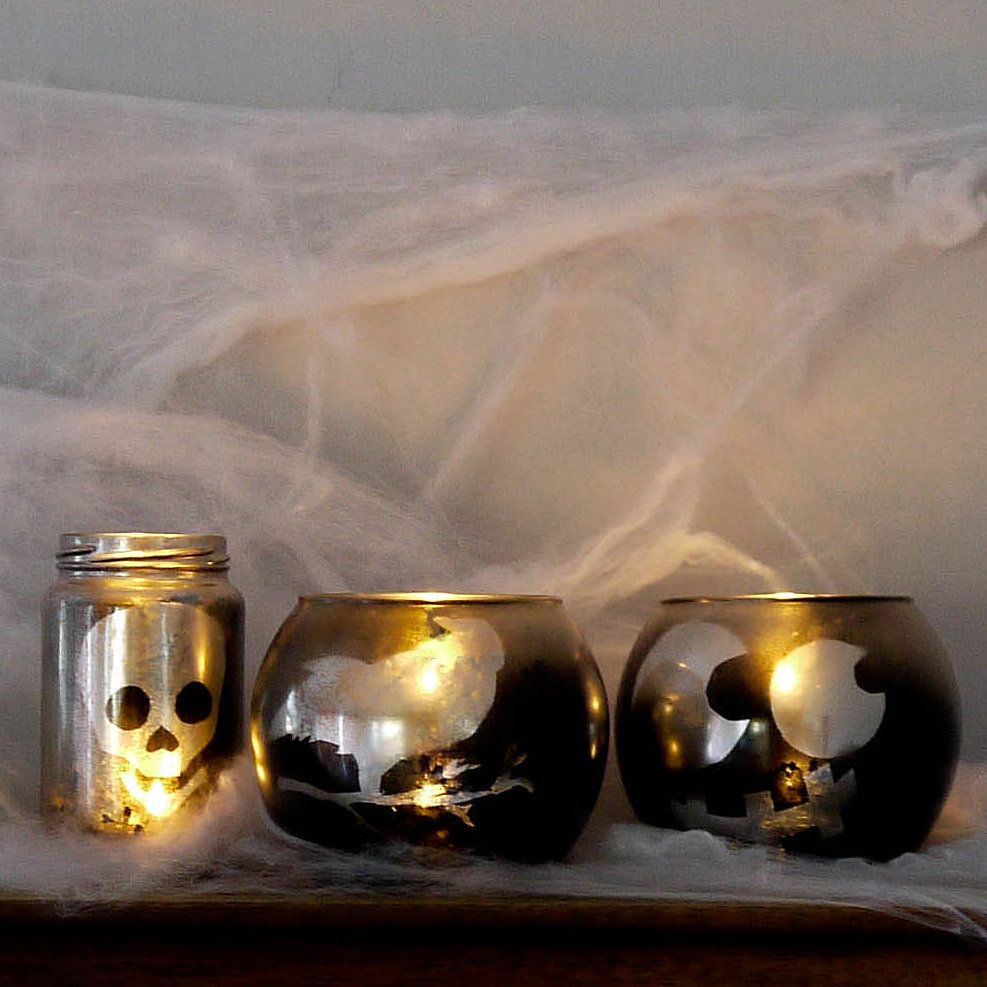 This Halloween Votive DIY Is So Easy, It's Scary!: Head to the dollar store and load up on votives or upcycle glass jars into these stunning and scary Halloween votives that make a statement.