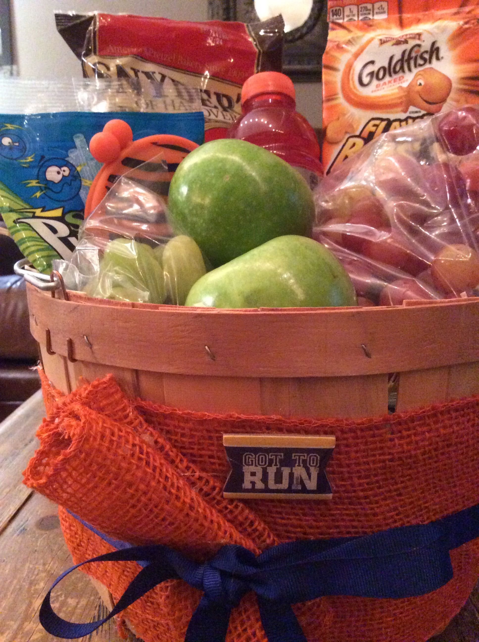 A gift basket or spirit basket for a runner cross