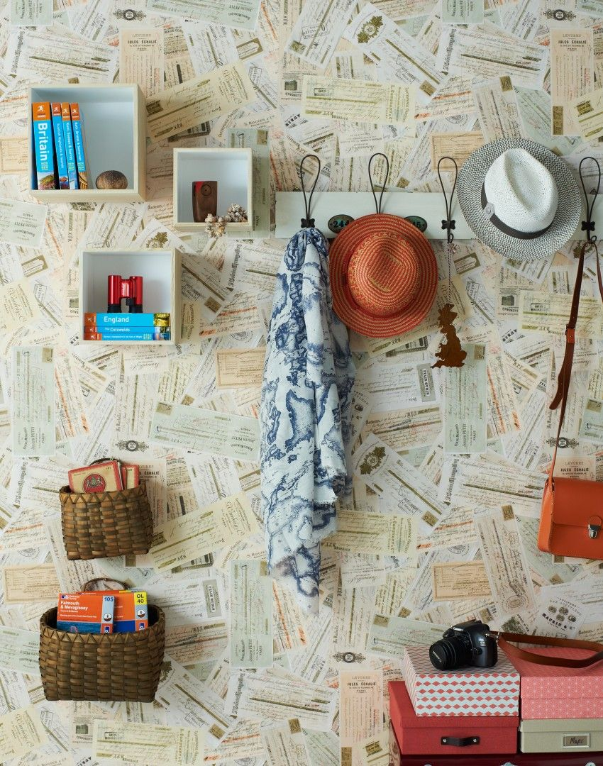 hallway with box shelves and travel themed wallpaper | wallpaper in