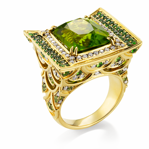 NAGA IJO: THE GREEN DRAGON JEWEL Serial No. RGP0930PEDI-R3526 A ring of 18k green gold with Peridot center stone framed in cognac Diamonds, with Tsavorite and diamonds set in a dragon scale motif on the shank. Naga Ijo means green dragon. The Naga is the cosmic dragon, symbolic of the life force.