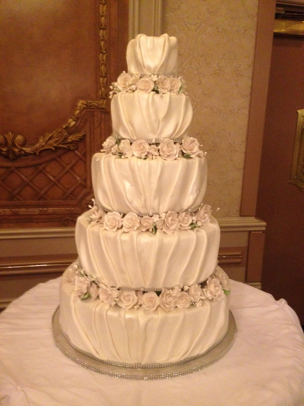 Beautiful separated tier wedding cake featuring handmade roses. Each ...