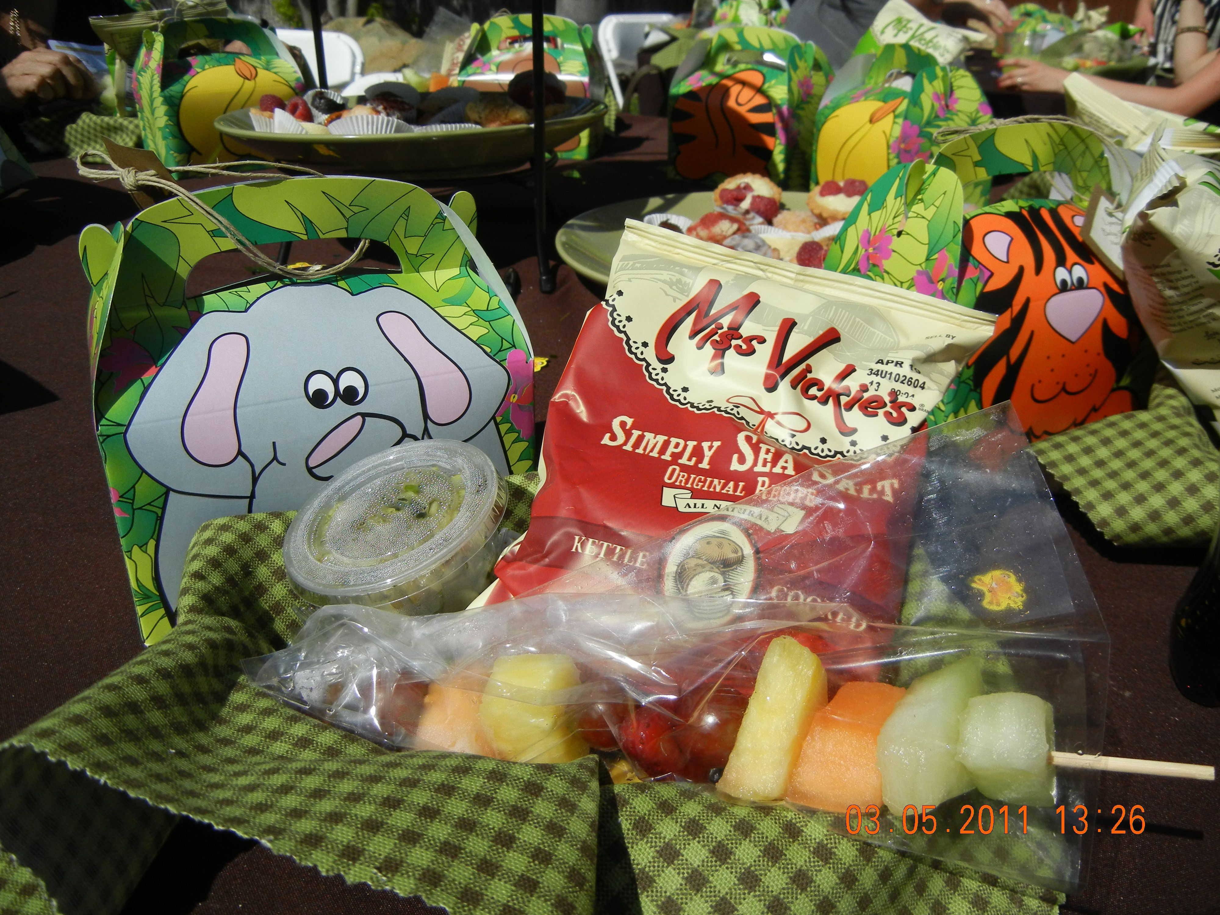 Baby shower theme: jungle.  these where the lunch set ups. fruit, chips sandwiches and crackers