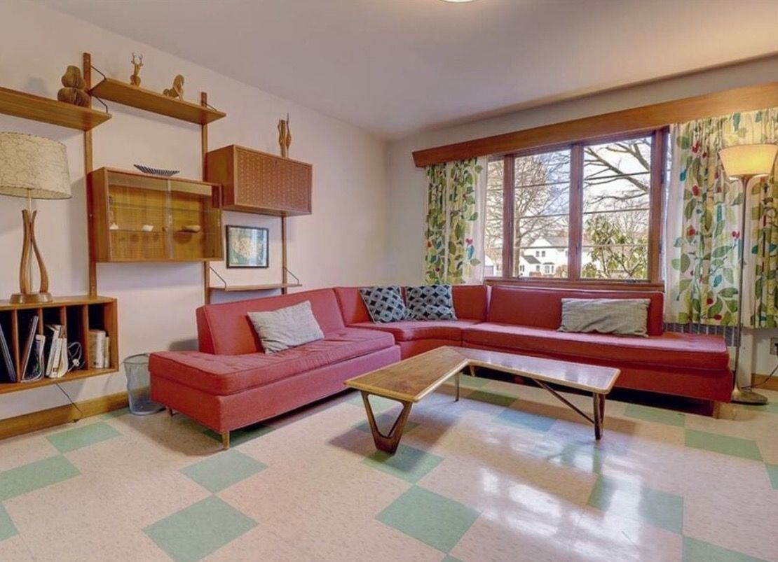 MCM pink couch living room with tile floors | Mid century ...