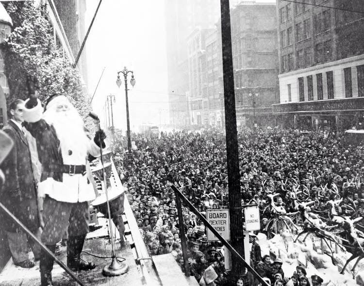 1940 Christmas time working in downtown Detroit Santa talking to the crowd in front of Hudsons department store.
