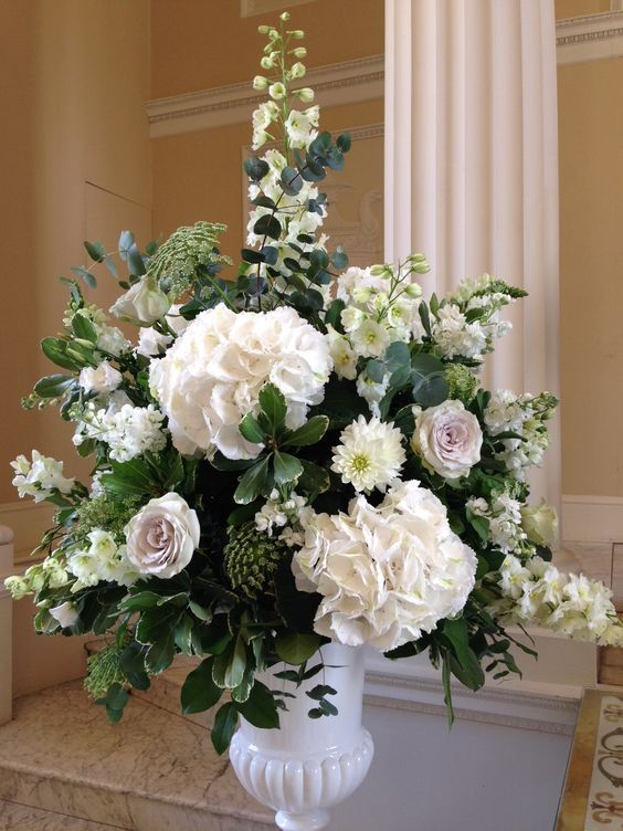 Muted shades of Hydrangea, Delphinium and Amnesia roses at Syon House
