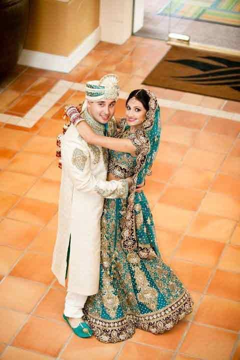 1db39b8776 Bride in zink green lehnga choli with dupatta and groom in white sherwani  with matching zink