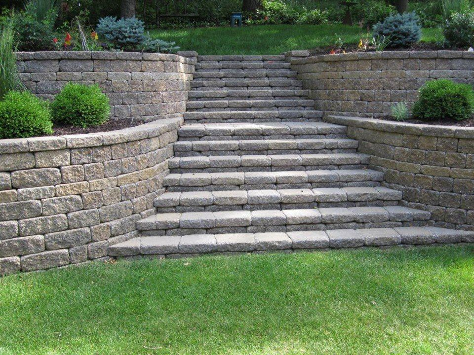 Tiered Retaining Wall With Curves And Stairs Sloped Garden Front Yard Landscaping Landscaping Retaining Walls
