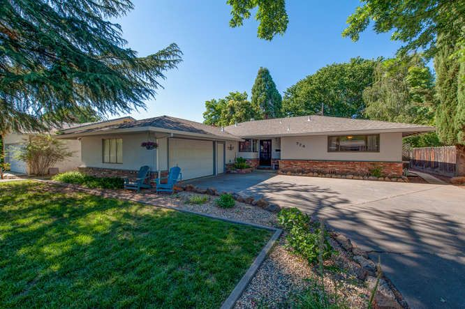 Looking for a home on a large lot, a great street, and is close to shopping, movies, freeways, schools and more? Come see this wonderful home featuring 3 bedrooms, 2 bathrooms, over 10,000 sf lot, 2 car garage, hardwood floors, updated ceiling fans and light fixtures, wood stove and more!