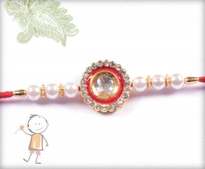 buy online rakhi - #Designer #Diamond #Traditional #Rakhi, Traditional Diamond Pendent Rakhi with Crystal Beads, surprise your loved ones with roli chawal, chocolates and a greeting card as it is also a part of our package and that too without any extra charges. http://www.bablarakhi.com/