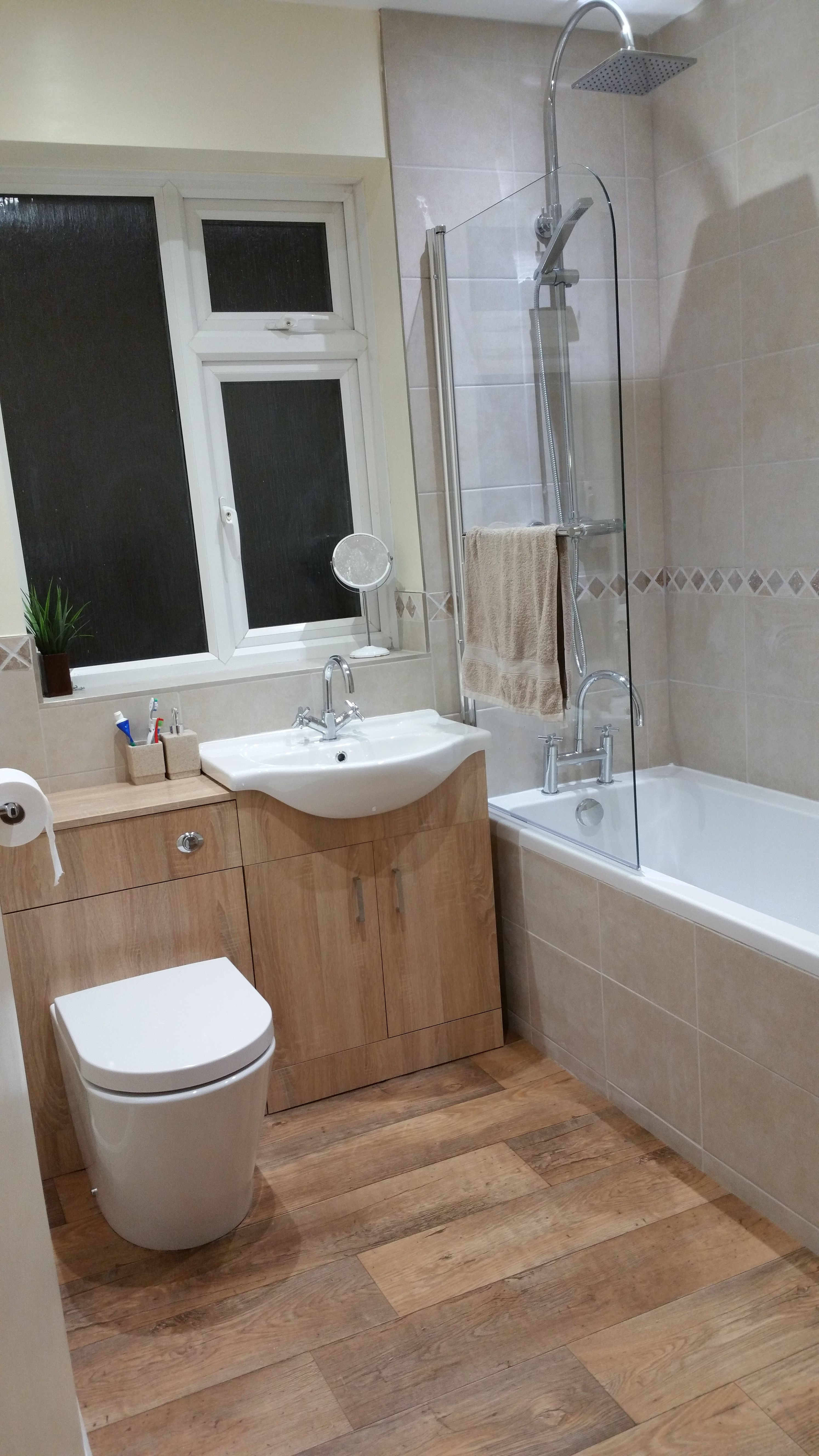 The back to wall toilet unit and oak vanity unit both come from the