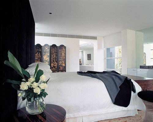Luxury-bedroom-in-light-shades-with-flowers-in-vase-for-decoration