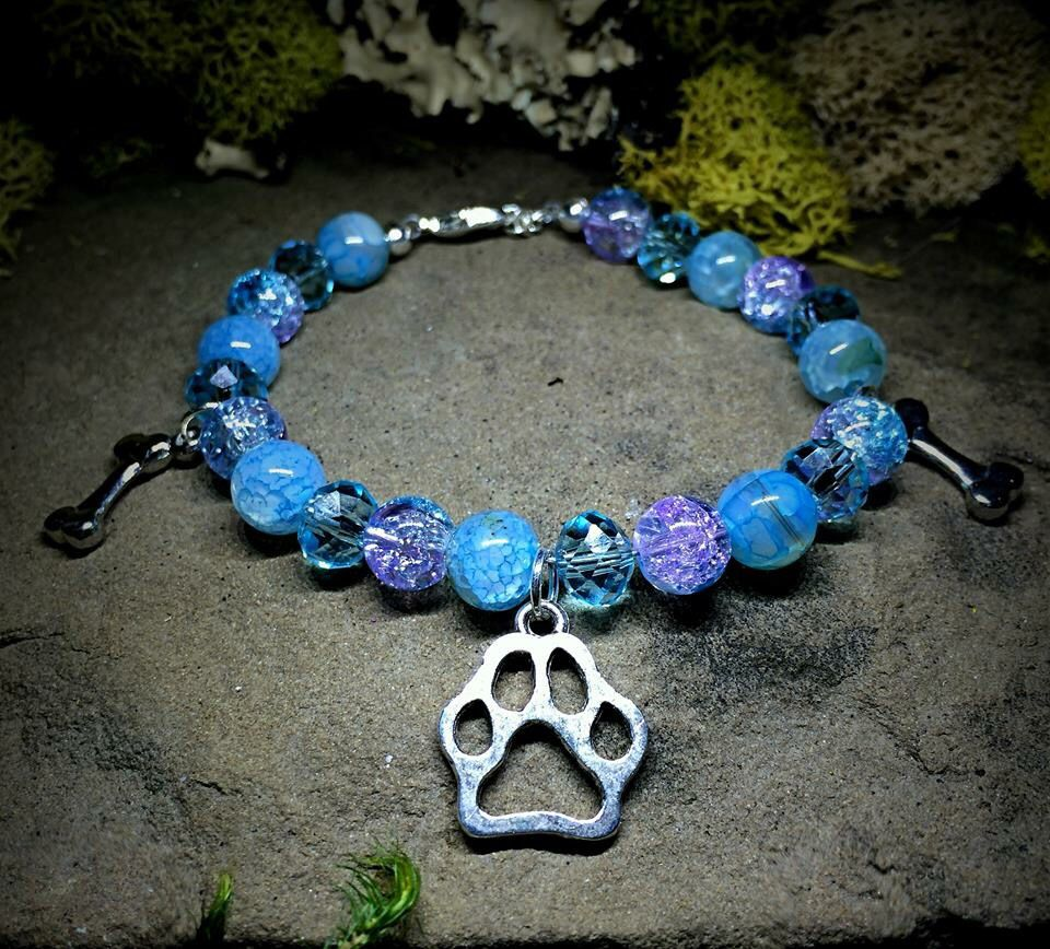 Jewelry that donates 5% to animal charities.  www.etsy.com/shop/nouveauyourself