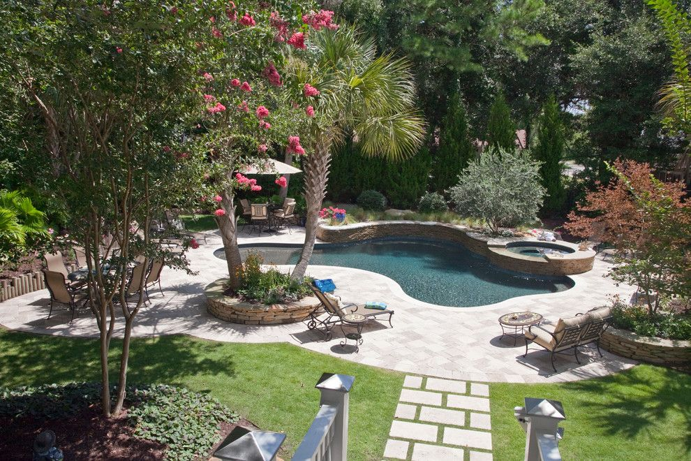Free Form Pool With Spa Combination Makes A Perfect For This Backyard Oasis Tropical Landscaping Pool Designs Backyard Landscaping Designs