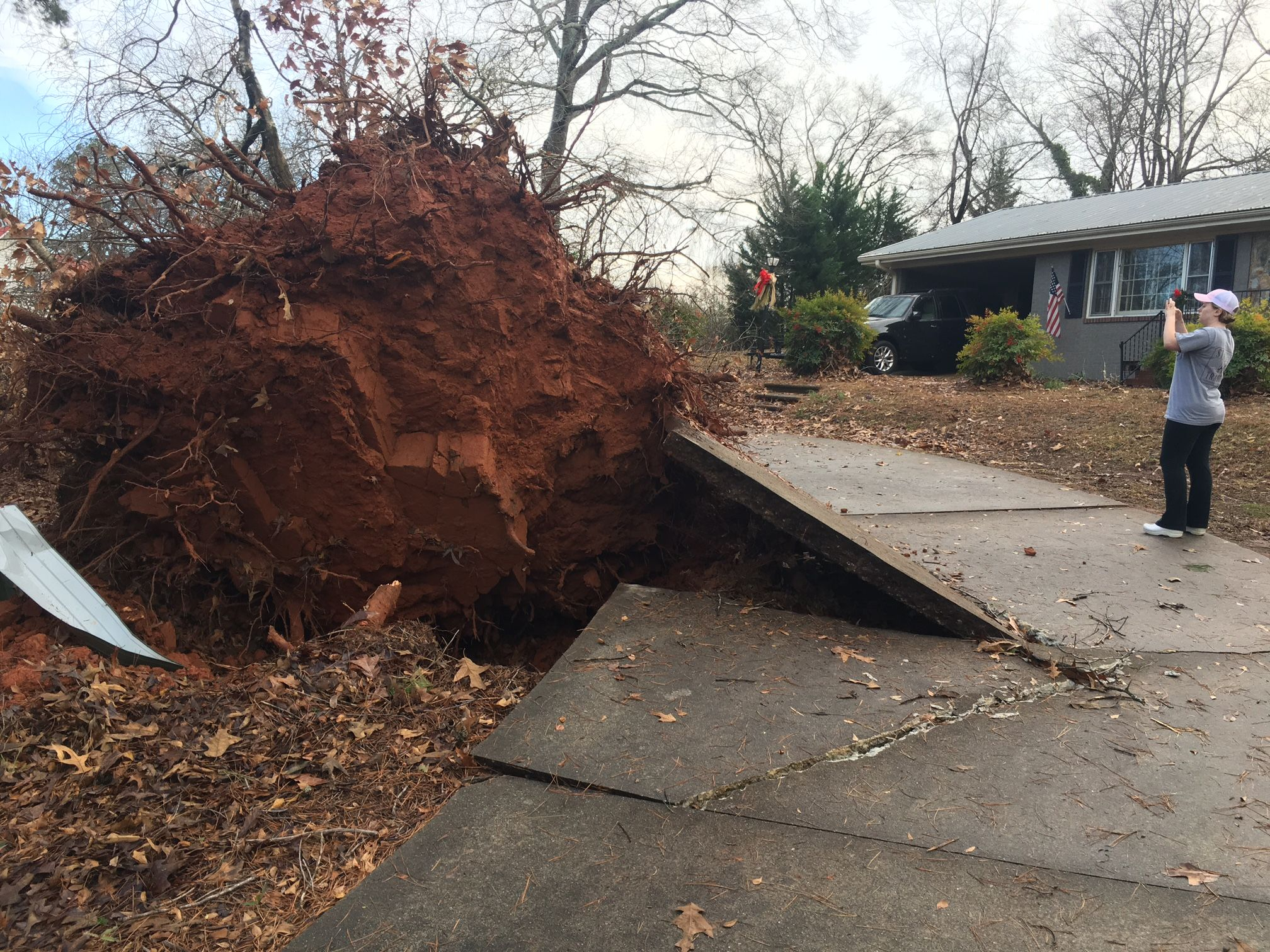 Homes damaged, trees and power lines down after storm