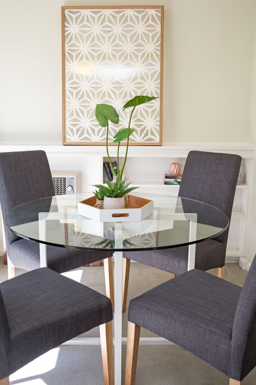 Small Dining Area Apartment Round Glass Top Table Grey Upholstered Chairs Plant Vignette