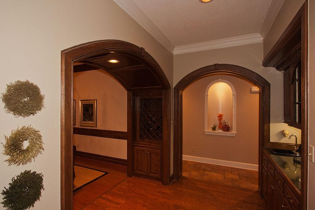Superior Rich Wood Cased Arched Opening To Dining Room Has Built In Wine Storage,  Shown On