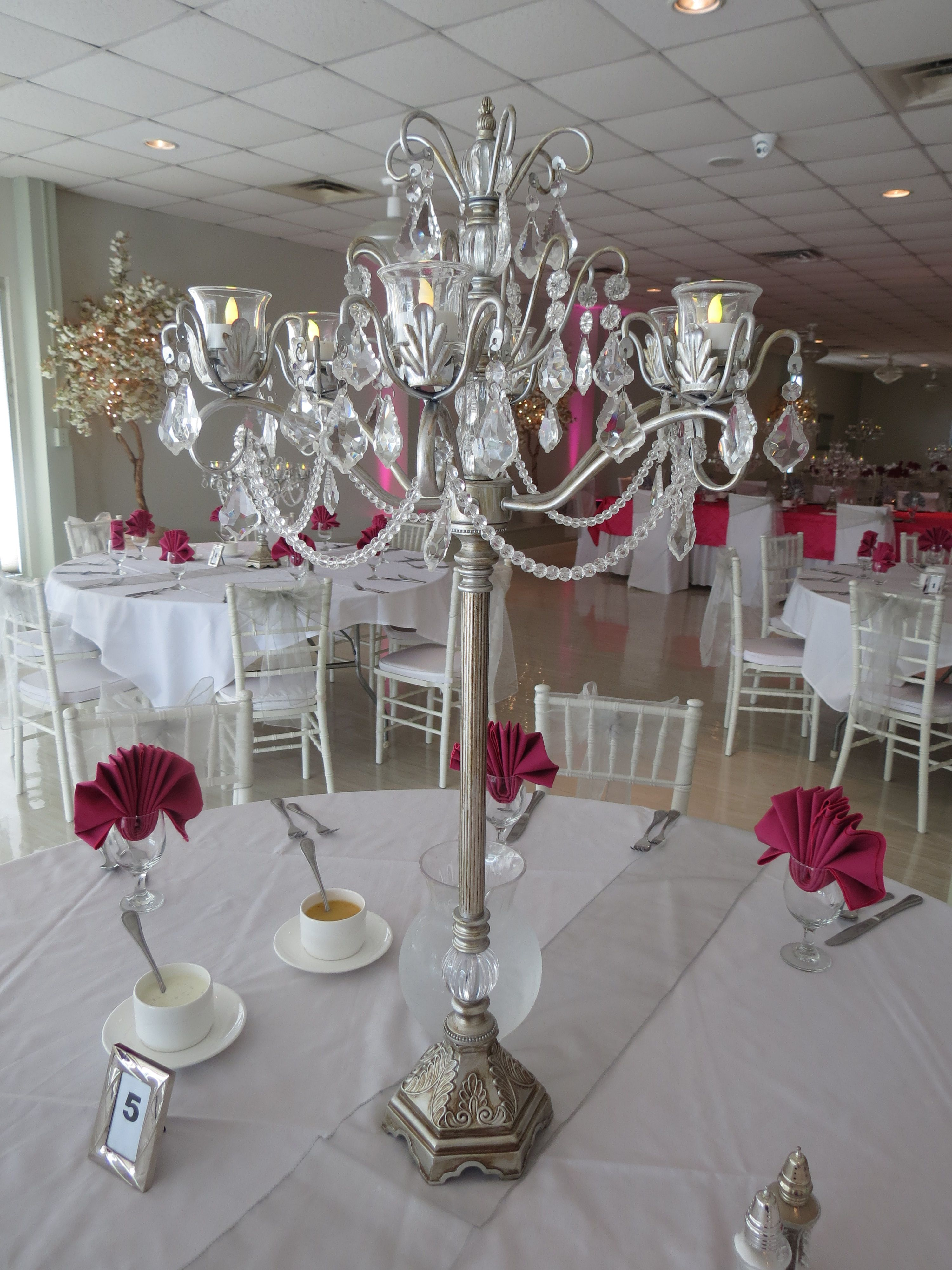 Antiqued Silver Chandelier Centerpieces with Hot Pink Napkins