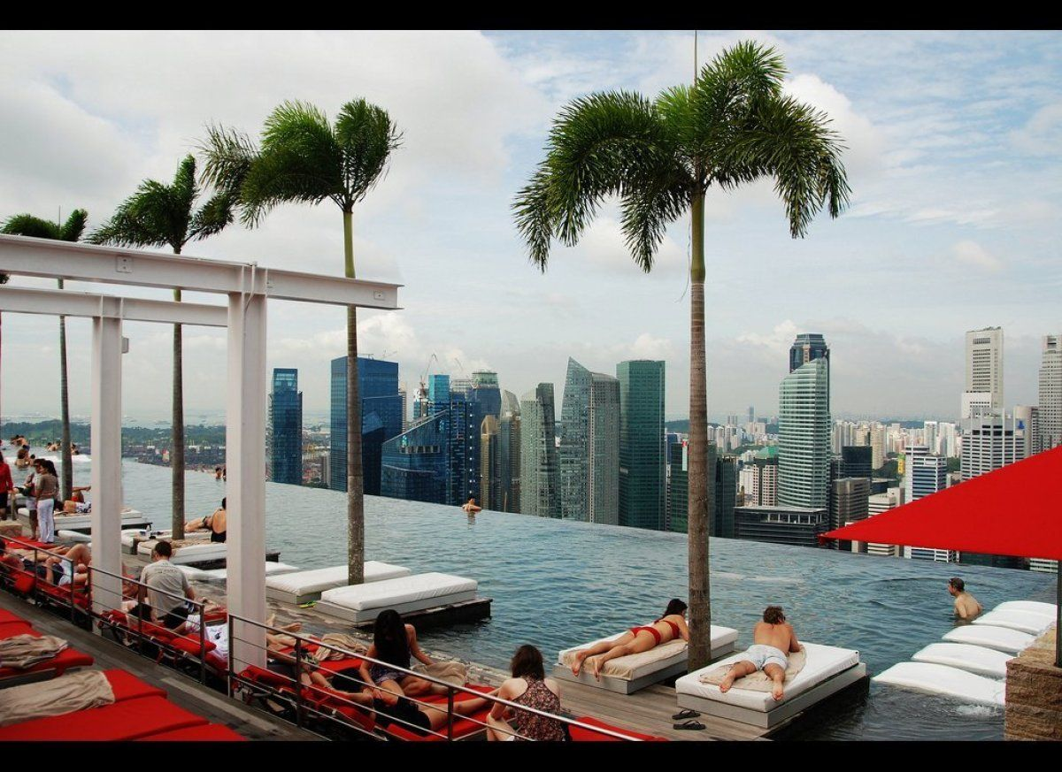 Marina Bay Sands, Singapore  The Skypark atop the Marina Bay Sands hotel in Singapore flaunts an extended vanishing-edge pool—some 57 stories above the ground. Insane!