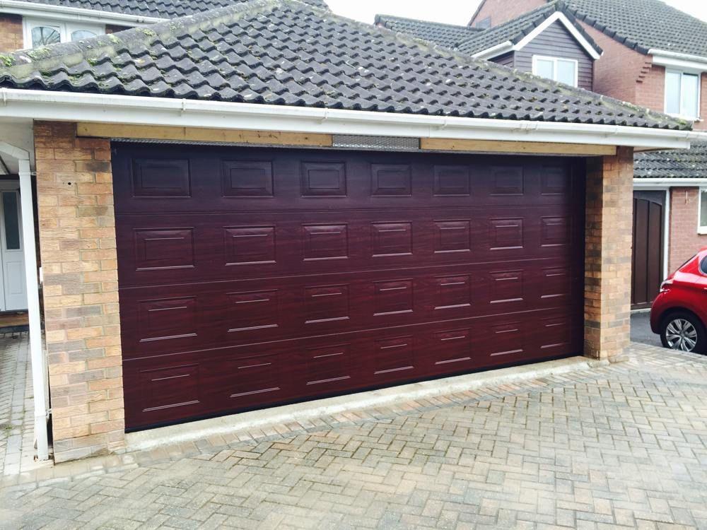 Many door designs from SA Garage doors come with built-in insulating properties or & Many door designs from SA Garage doors come with built-in insulating ...