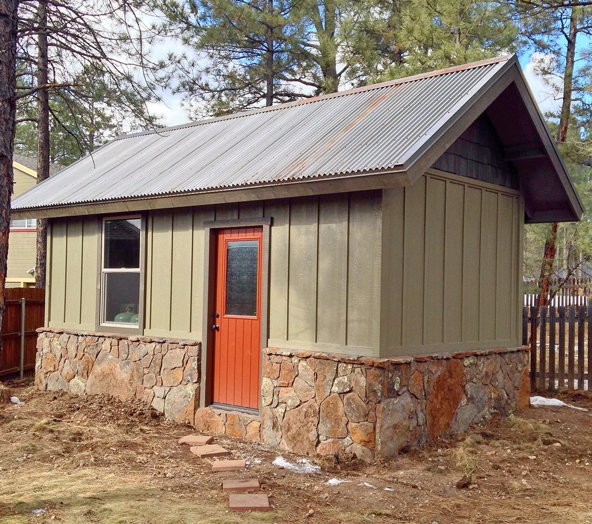 A new custom shed with a metal roof the siding on this for Metal board and batten siding