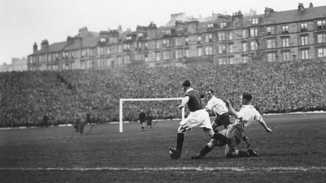 A big match at Hampden with the tenements of Somerville Drive in the background.