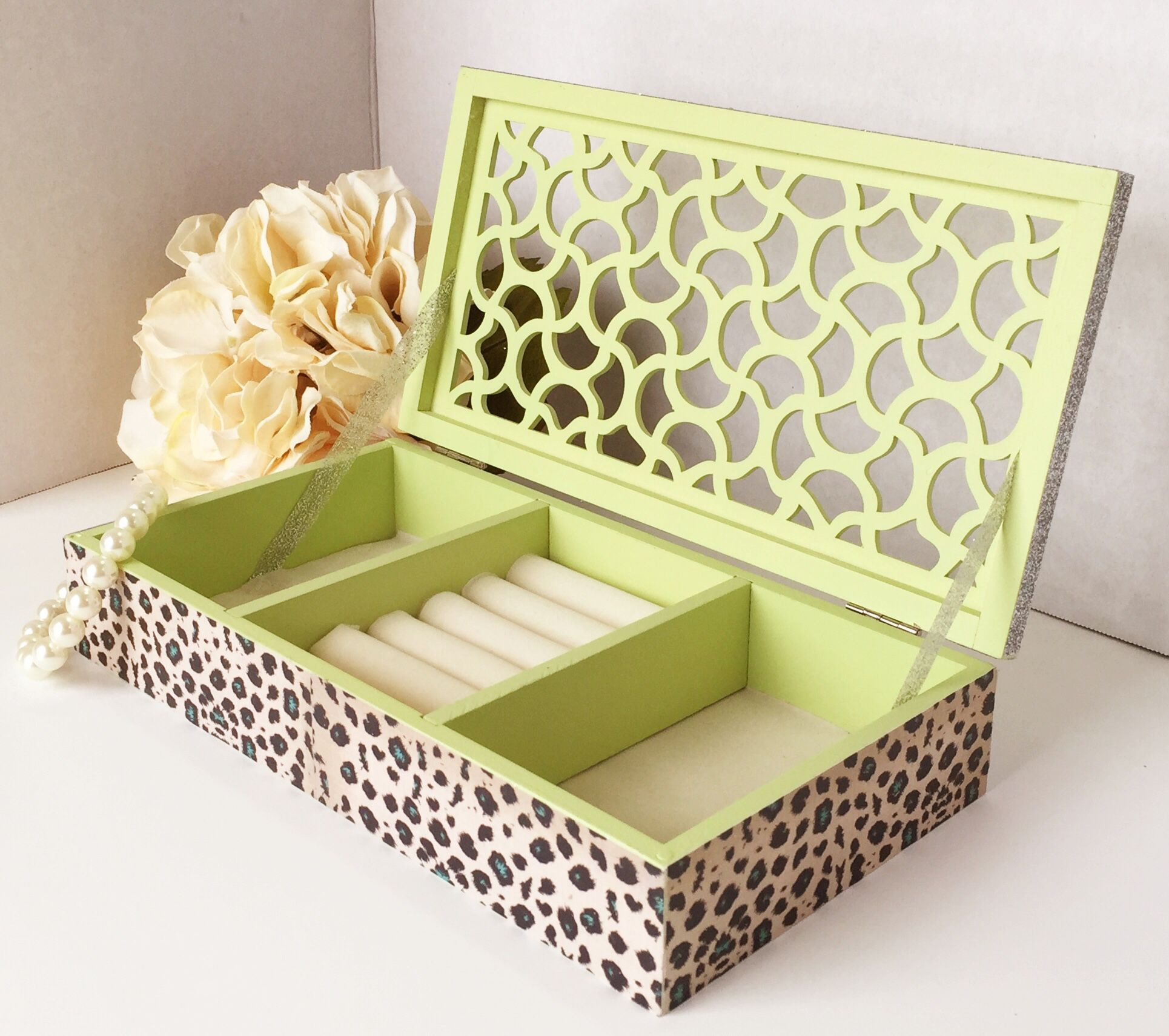 A gorgeous cheetah print padded Jewelry box with ring storage