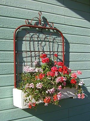 Garden gate made into a hanging flower box  Love this idea!