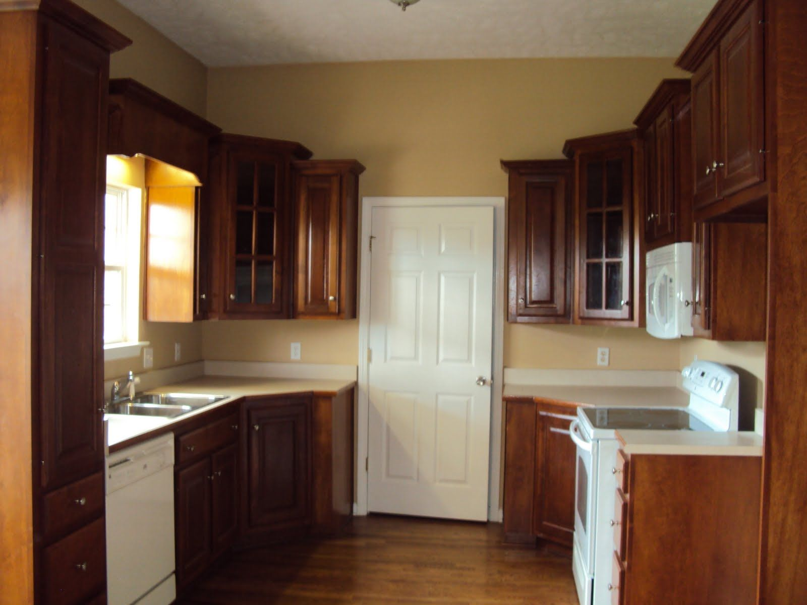 cherry cabinets with white appliances, light counter top ...