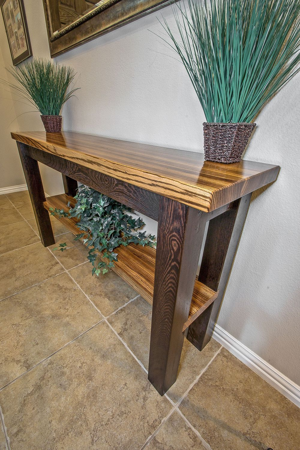 This beautiful zebrawood accent table is completely built by hand