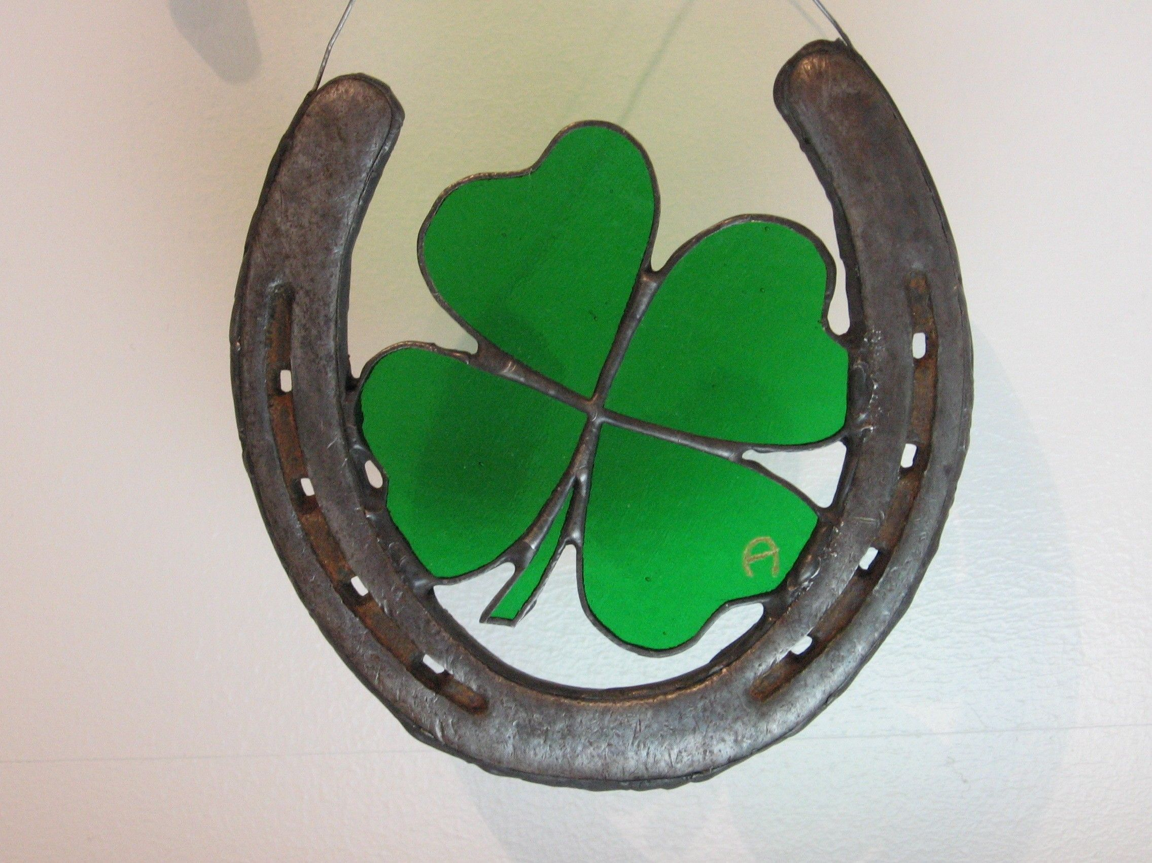 Horseshoe with four leaf clover stained glass and raw leather cord