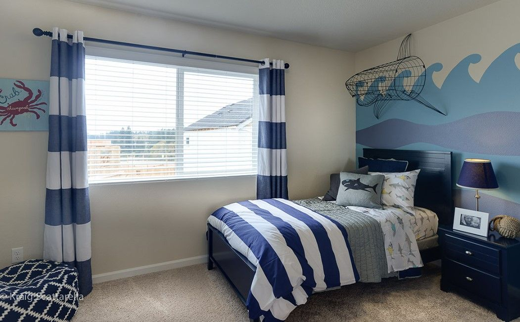 Boy's under the sea themed room. Love the fun waves painted on the wall! #DRHorton #FindYourHome