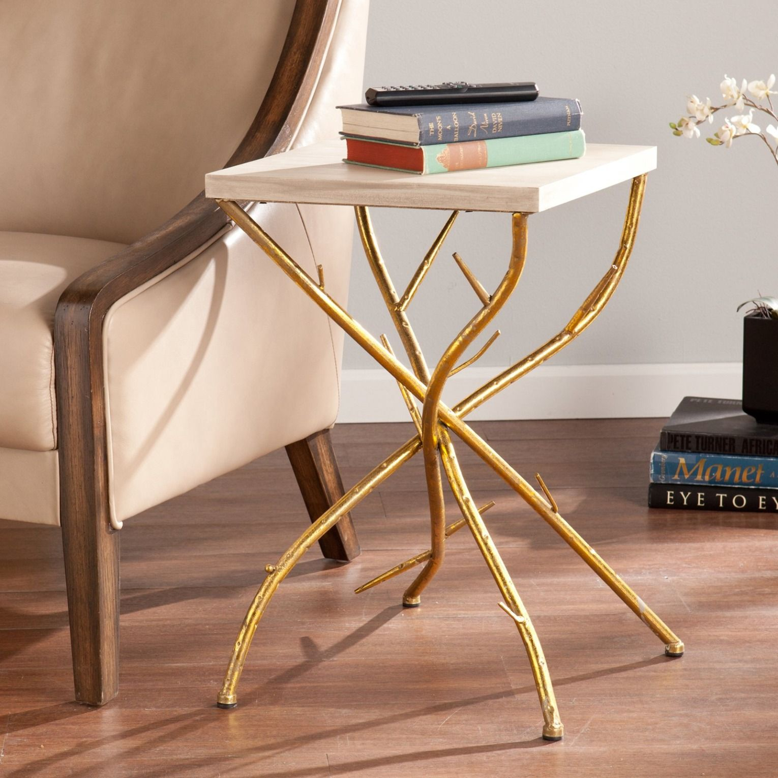 This gold end table adds glamour to any setting