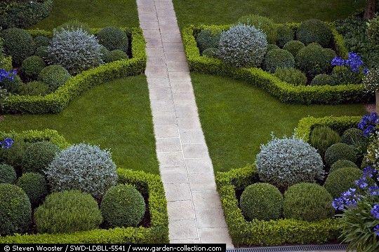 tässä esimerkki parkkialueen ja puutarhan aidaksi