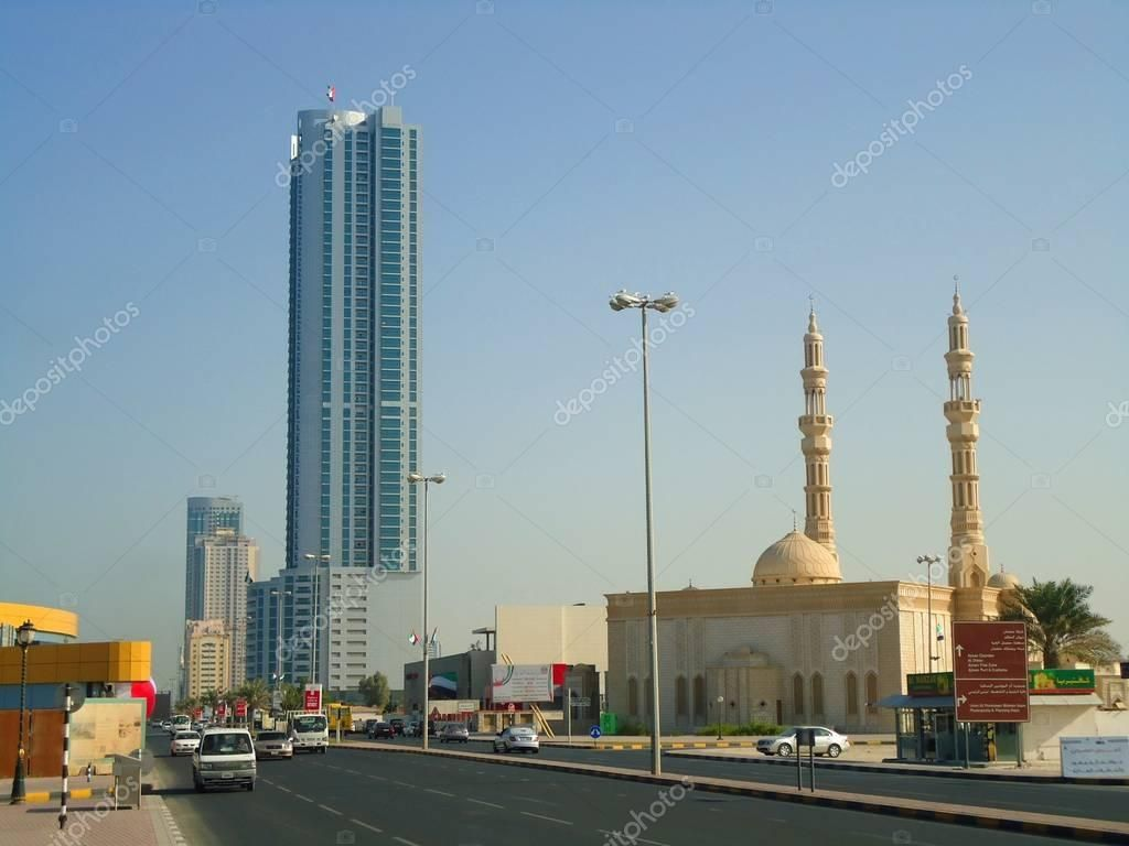Skyscraper and mosque in Sharjah - Stock Photo , #sponsored, #mosque, #Skyscraper, #Sharjah, #Photo #AD