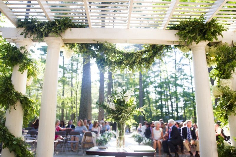 A beautiful forest wedding with an elegant altar decorated ...