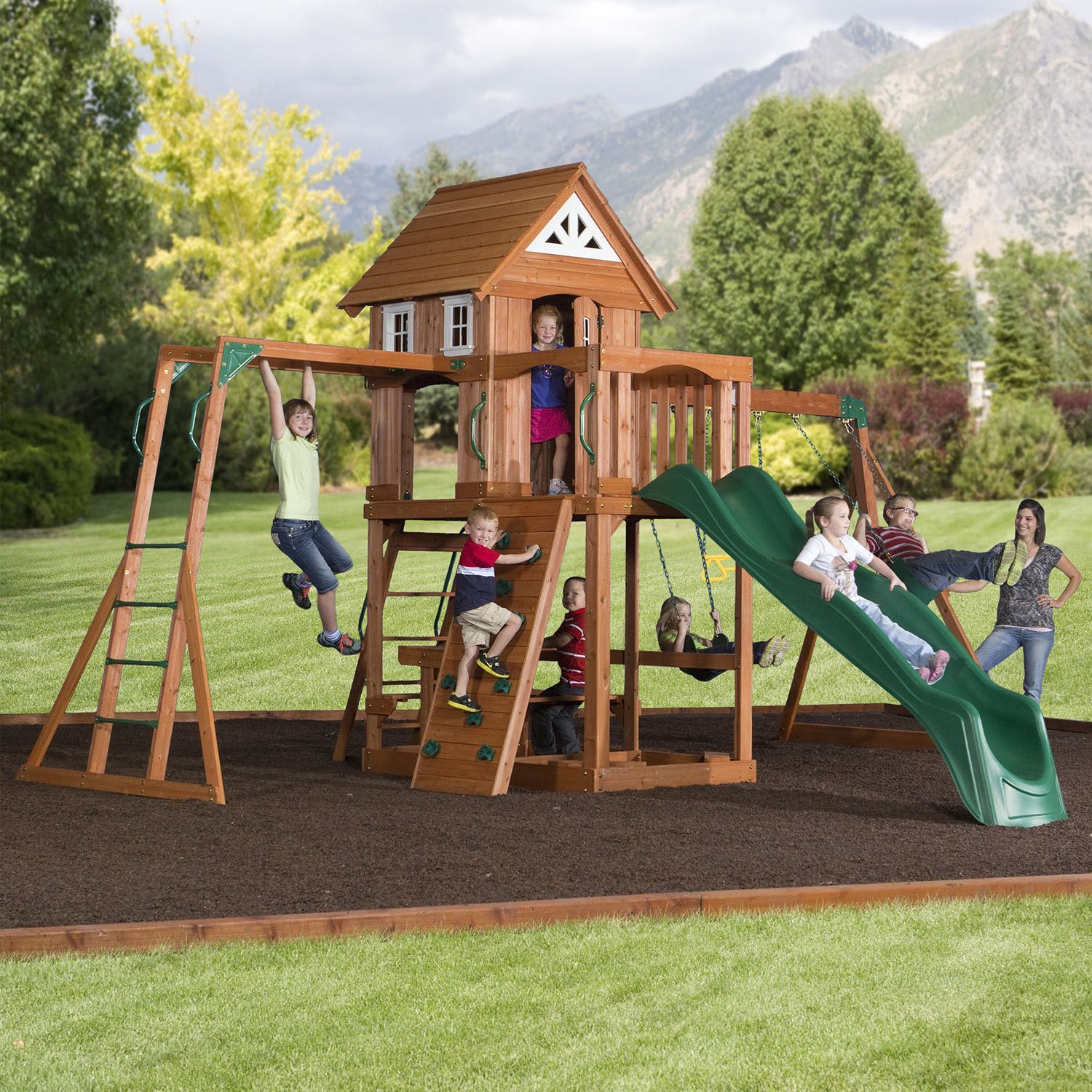 The Cedar Peak is a great swing set that is all cedar, with a monkey bar beam and a swing beam. It has an upper fort that has a wood roof, sunburst end gables a
