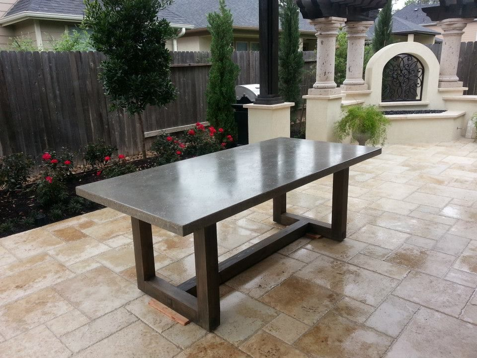 Custom concrete 84x40 Dining table in Cola color It sits on a wood