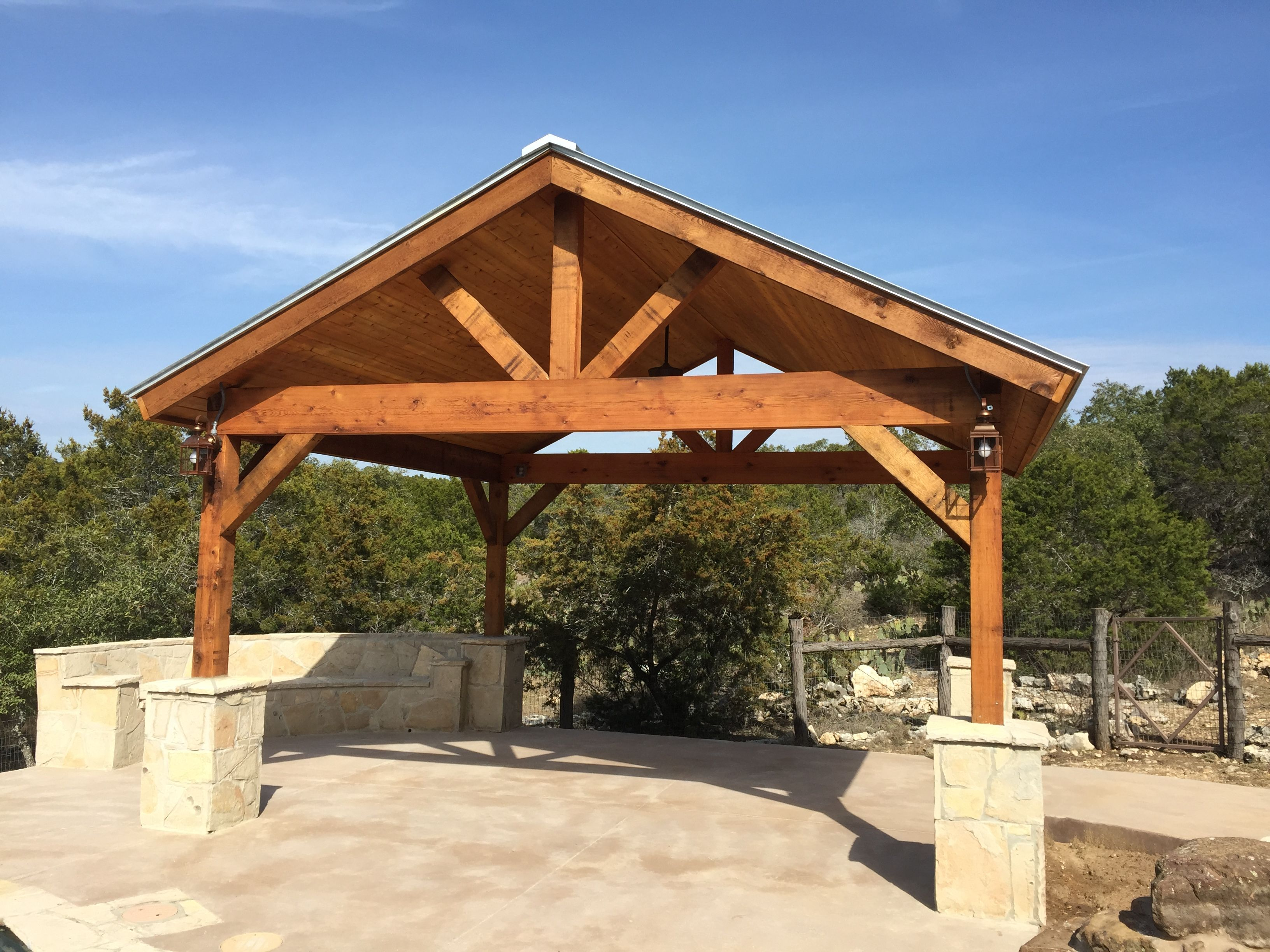 Pergola with stone faced seating area and stained concrete