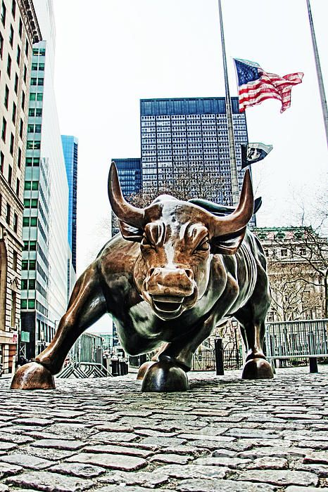 Charging Bull Statue Near Wall Street And The New York Stock