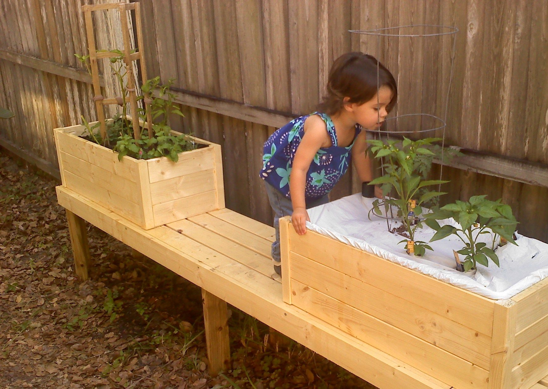 Modified to fit an Earthbox and mounted to a bench Do It