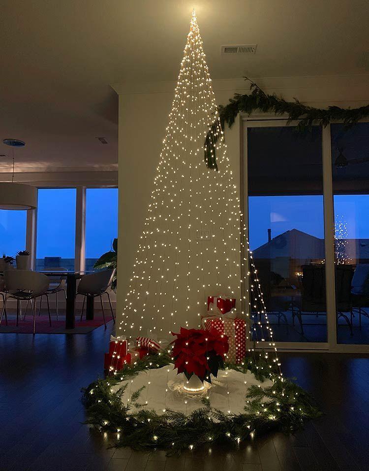 These Alternative Christmas Tree Ideas Take Holiday Creativity To A New Level Creative Christmas Trees Diy Christmas Tree Christmas Lights