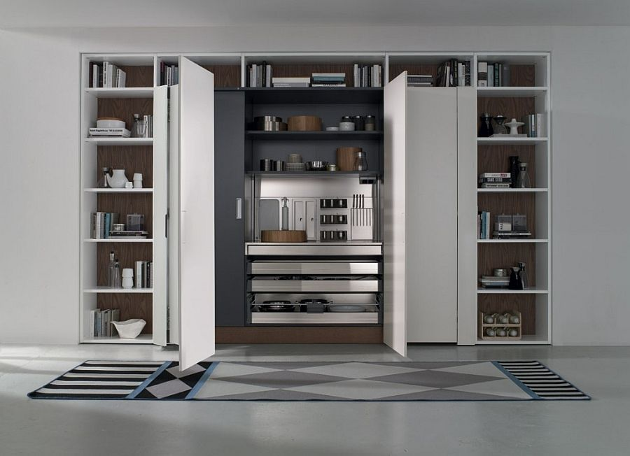 Tall kitchen unit with pocket doors combines form with function ...