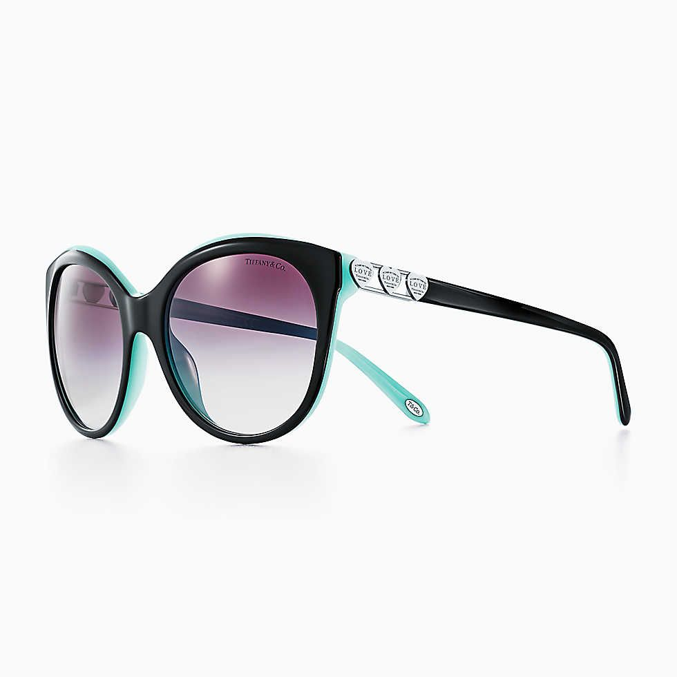 75bc29758a5 Return to Tiffany® Love round sunglasses in black and Tiffany Blue acetate.