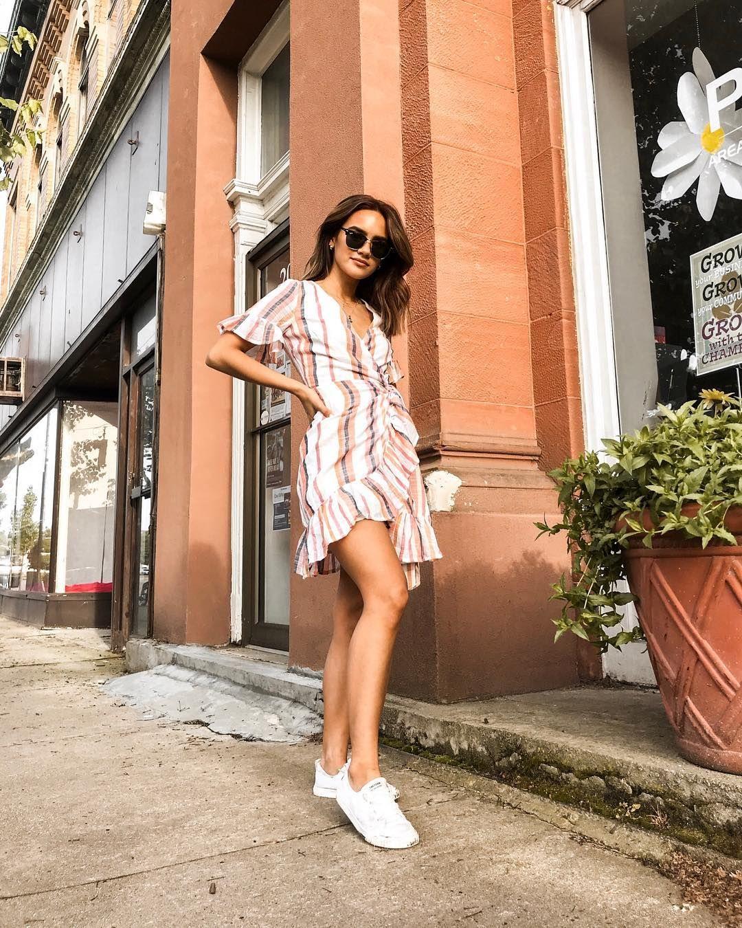 A Summer Wrap Dress And Sneakers Your Weekend Wardrobe In Warmer Temps Multi Striped Ruffle Wrap Fro Tie Front Dress Dress With Sneakers Summer Wrap Dress [ 1350 x 1080 Pixel ]