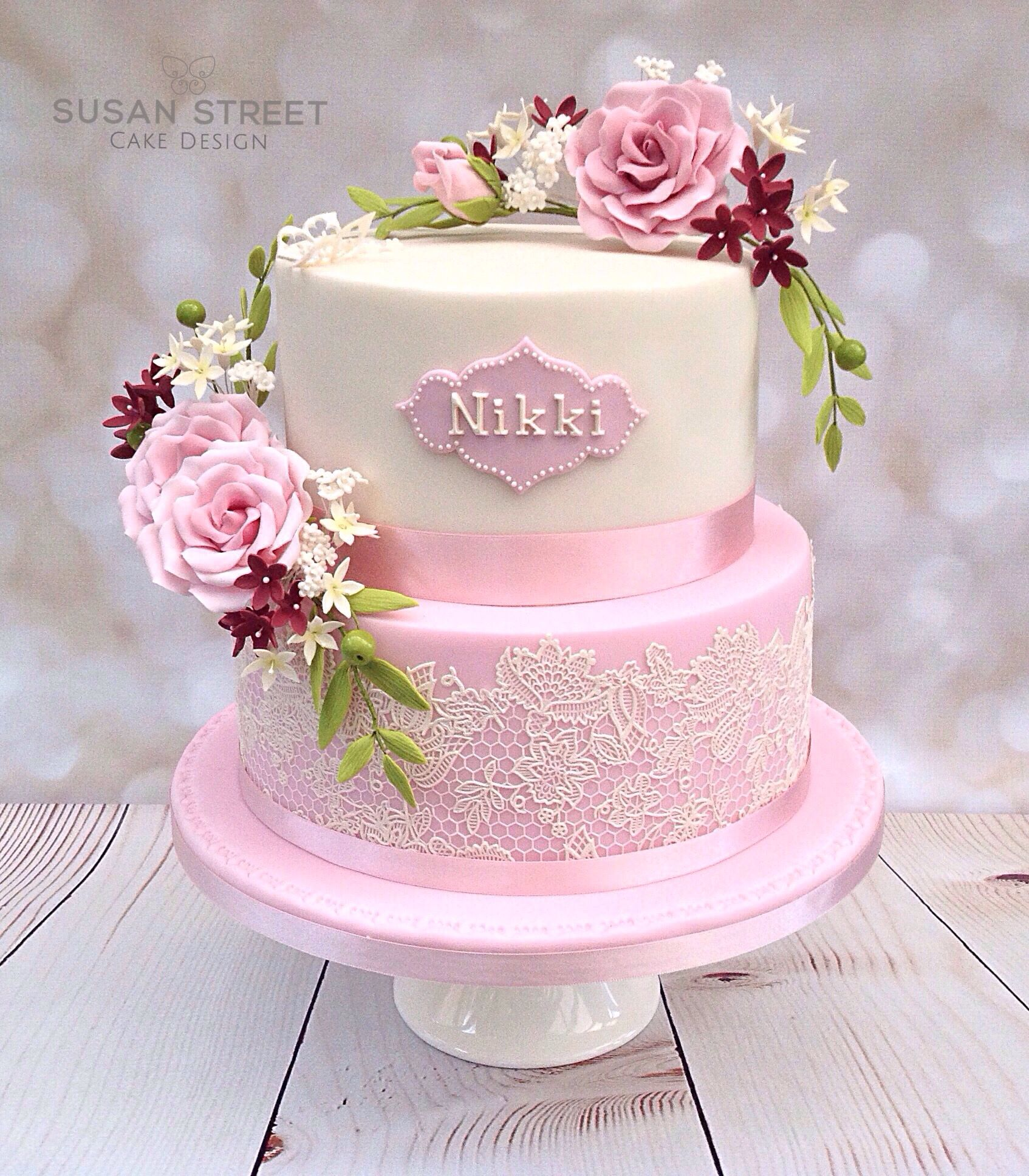 Vintage style two tier birthday cake with dusky pink flowers and ...