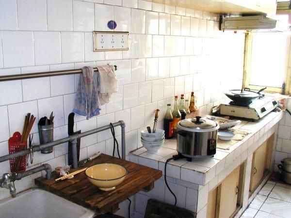 This Is How Typical Chinese Kitchen Looks Like. Chopsticks And Spoons  Arranged Together, Some