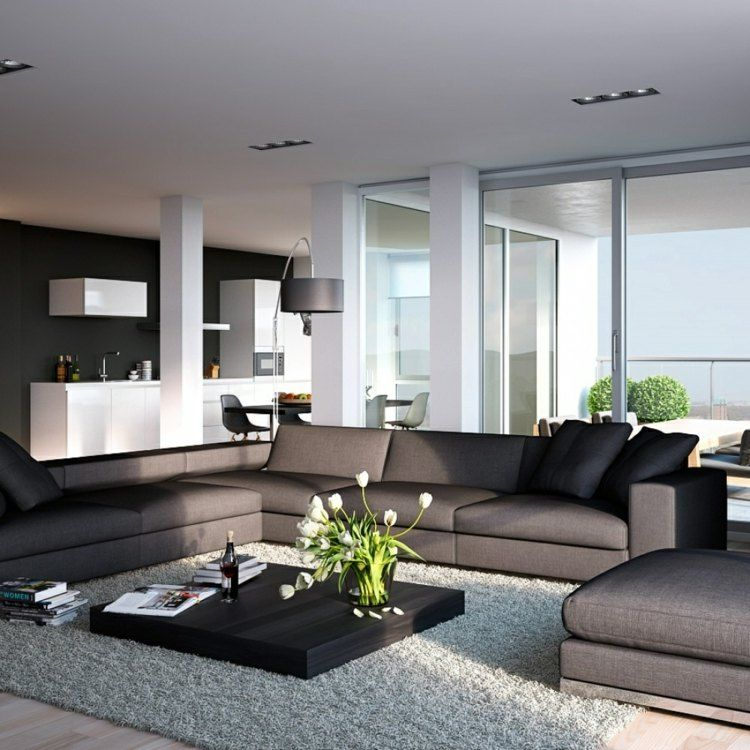 Schlichtes Wohnzimmer Design mit dunkelgrauer Couch und weißer - wohnzimmer braun weis grun