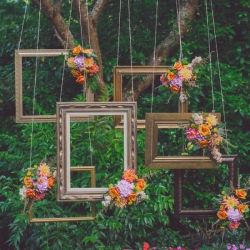 This amazing suspended ceremony backdrop made of mix matched frames works so well! {photo: One Love Photo}